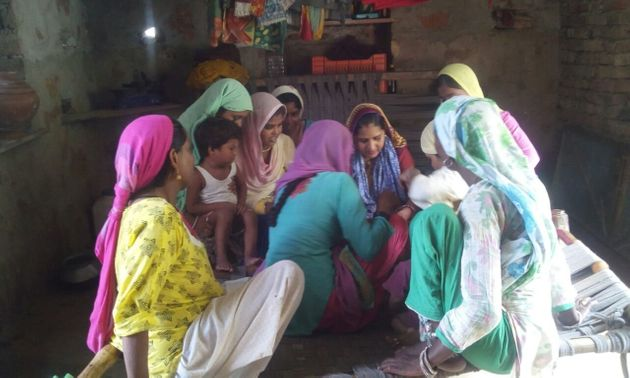 Seema Prajapat teaches a group of women in her village in
