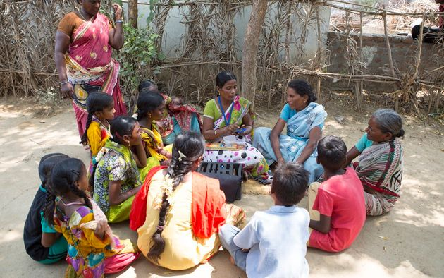 Bujji teaches a group of women in her village in Andhra