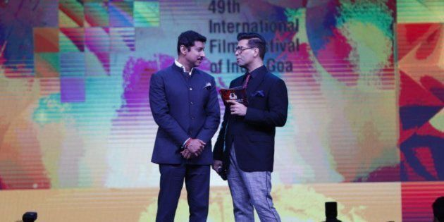 Rajyavardhan Rathore and Karan Johar at the opening ceremony of IFFI 2018 on Tuesday.