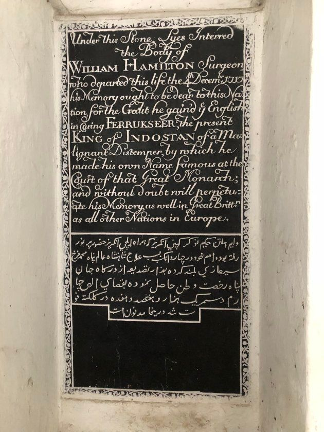 The grave of Scottish surgeon William Hamilton at St. John's Church in Kolkata. Hamilton, who cured Emperor Farrukhsiyar, was allowed to maintain a territory of 38 villages on the banks of the Hooghly River. This began the East India Company's fortunes in India, and ultimately led to the end of the Mughal empire.