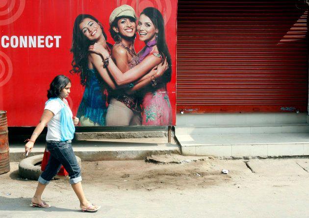 A girl walks past a closed shop in Siliguri February 12,
