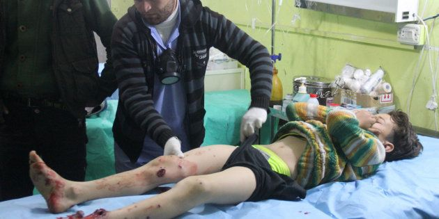 EDITORS NOTE: Graphic content / A Syrian child receives treatment at a hospital in Khan Sheikhun, a rebel-held...