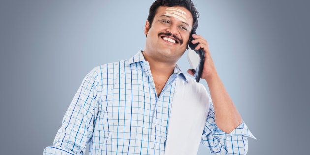 South Indian man talking on a mobile phone and