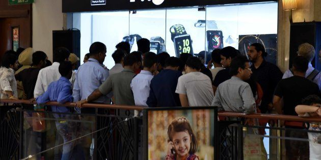 NEW DELHI, INDIA - OCTOBER 7: People standing in queue during the launch of new iPhone 7 at world showroom...