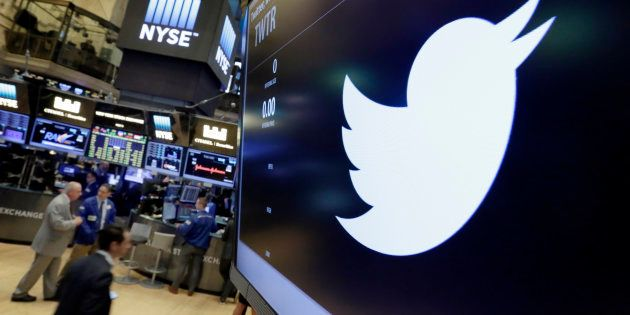 The Twitter symbol appears above a trading