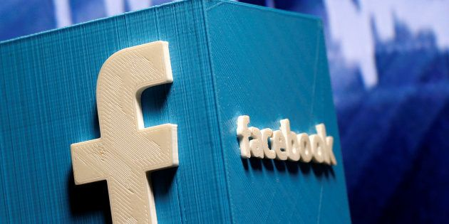 A 3D-printed Facebook logo is seen in front of a displayed stock graph in this illustration taken November...
