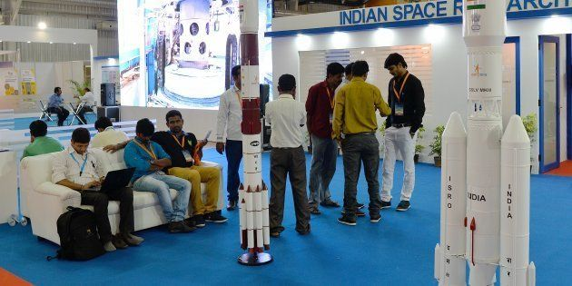 Visitors look at the model of Satellite launch vehicle at the ISRO stall in Bangalore International Exhibition...