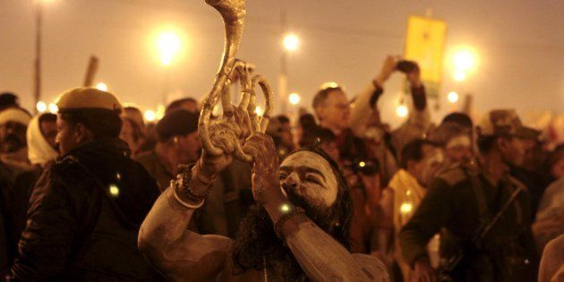 'Naga sadhus' perform rituals on the banks of the Ganga River during the Maha Kumbh festival in Allahabad....