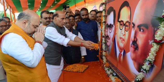 BJP National President Amit Shah and Union Home Minister Rajnath Singh paying floral tributes to the...