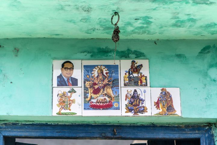 Images of Bhimrao Ramji Ambedkar known as Babasaheb, India's first minister of law and justice and a social reformer who inspired the Dalit Buddhist Movement, top left, and gods and godesses are displayed outside a house in in Sambhal, Uttar Pradesh, India, on Monday, Aug. 22, 2016. Prime Minister Narendra Modi's Hindu-nationalist Bharatiya Janata Party (BJP) is seeking to woo Dalits in order to win the state's legislative elections, which would give him greater momentum to push his economic agenda at the national level. While the BJP dominated Uttar Pradesh in the 2014 national elections, Modi faces a tough fight for Dalit votes against several caste-based parties -- in a state where caste is the most important factor for voters. Photographer: Prashanth Vishwanathan/Bloomberg via Getty Images