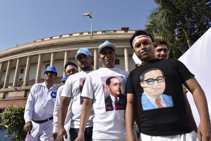NEW DELHI, INDIA - APRIL 14: People pay tributes during the floral tribute ceremony of Dr. B.R. Ambedkar on his 125th birth anniversary at Parliament House, on April 14, 2016 in New Delhi, India. Born on April 14, 1891 to Bhimabai Sakpal and Ramji in Madhya Pradesh, Ambedkar was the Chief Architect of India's constitution. He died on December 6, 1956. (Photo by Arvind Yadav/Hindustan Times via Getty Images)