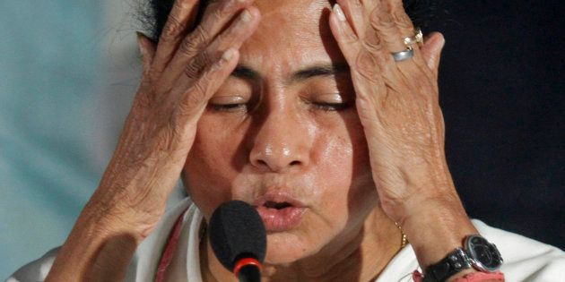 Mamata Banerjee, Chief Minister of India's eastern state of West Bengal, gestures during a news conference...