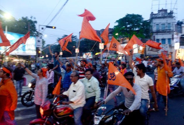 Hindu devotees rallied with saffron flags and shouted slogan during the