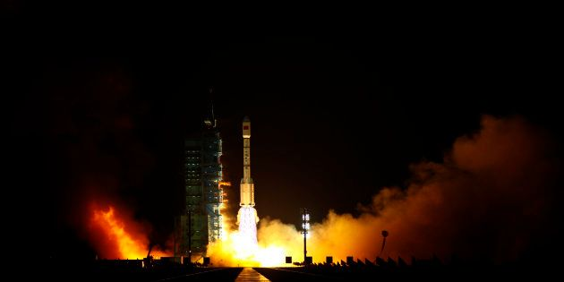 The Long March II-F rocket loaded with China's unmanned space module Tiangong-1 lifts off from the launch...