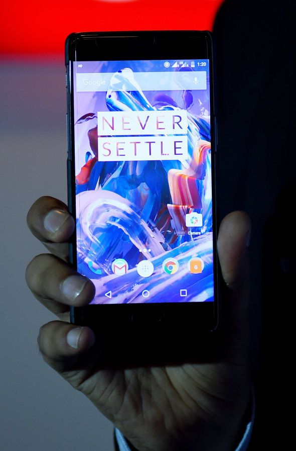 Vikas Agarwal, General Manager for Indian of the OnePlus cellphone company holds a newly-launched OnePlus