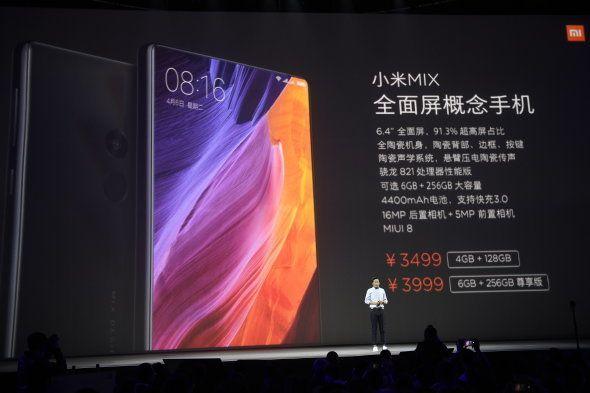 BEIJING, CHINA - OCTOBER 25: Lei Jun, Chairman and Chief Executive Officer of Xiaomi Inc., introduces...