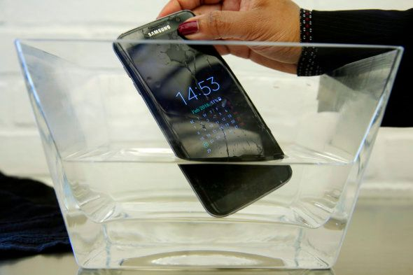 FILE - In this Feb. 22, 2016, file photo, a waterproof Samsung Galaxy S7 Edge mobile phone is submersed...
