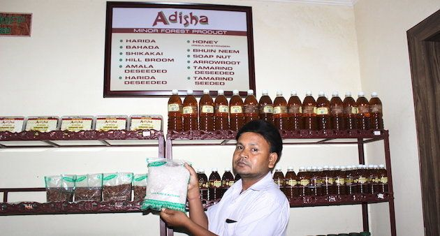 At a Bhubaneswar government outlet for minor forest products, a shop assistant holds up their fastest...