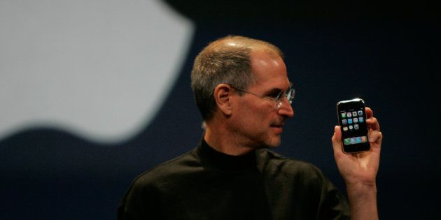 Apple Computer Inc. Chief Executive Officer Steve Jobs holds the new iPhone in San Francisco, California...