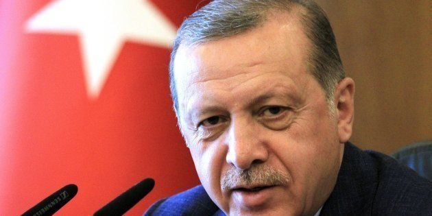 Turkish President Recep Tayyip Erdogan speaks during a press conference ahead of his departure for India,...