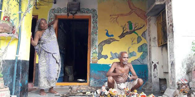 A toy maker and his wife in Raghurajpur village in