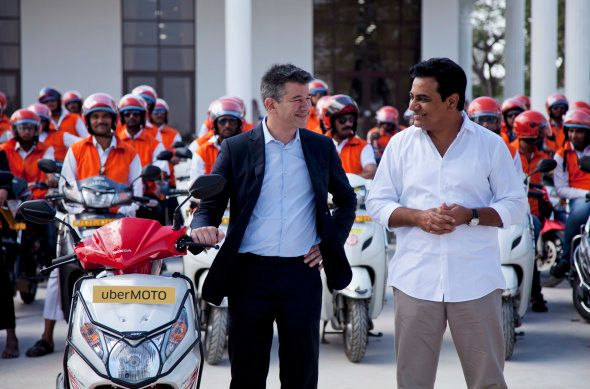 Uber CEO Travis Kalanick, center, gestures to Telangana state minister for Information and Technology,...
