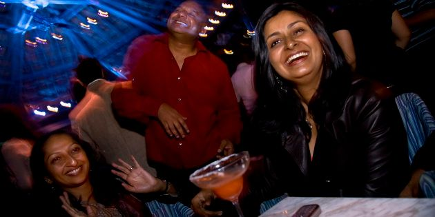 IT consultant, Bejoy George with his wife, Bina and friends enjoy a night out at a club in Bangalore....