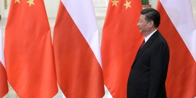 China's President Xi Jinping waits to meet Poland's Prime Minister Beata Szydlo, ahead of the upcoming...