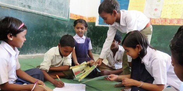 Children issuing books at the Anandghar library in Kajrah village in Balaghat.
