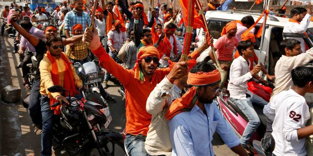 Hindu Yuva Vahini vigilante members take part in a rally in the city of Unnao, India, April 5,