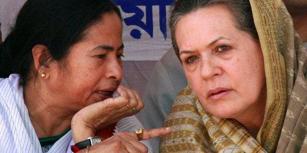 File photo of Trinamool Congress chief Mamata Banerjee (L) and Congress party president Sonia Gandhi