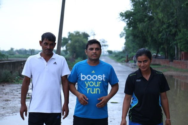 Alakhpura government school's PE teacher Gordhan Dass with the team coach Sonika Bijaria and her husband,...
