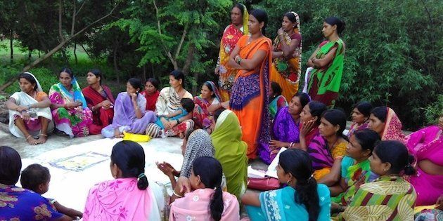 A woman's meeting in Jehanabad discussing the benefits of building toilets in homes.