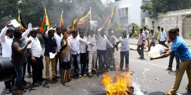 Members of Tamil Munnetra Padai stage a demonstration around superstar Rajinikanth's house in the locality...