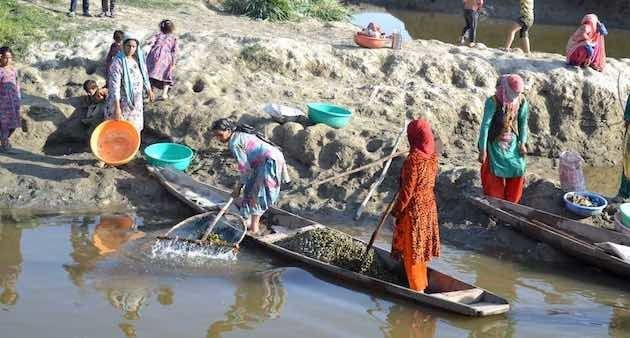 Women washing water chestnuts at the shore of Wular lake in Saderkote after a day-long collection. (Photo...