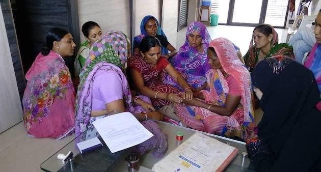 Women gift a widow colorful bangles, saree and bindi once the rituals for the deceased are over, as a...