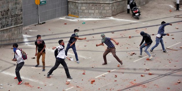 Demonstrators throw stones towards the Indian police during a protest in Srinagar, May 9, 2017. REUTERS/Danish