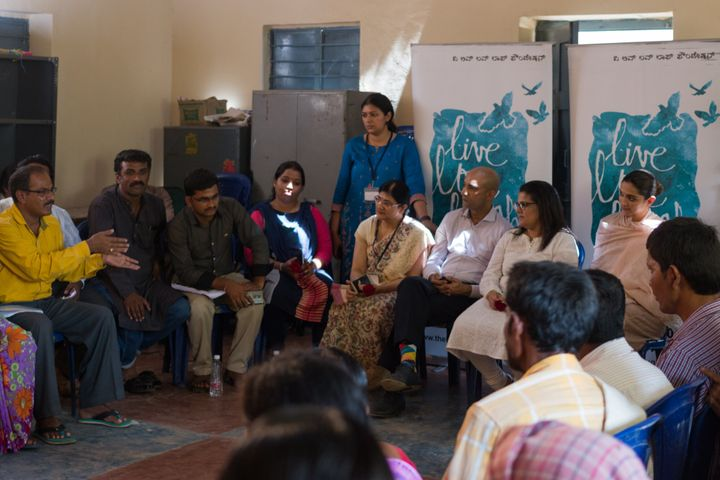 Deepika Padukone (seated, eighth from left) with the TLLLF and APD teams during an interaction with residents of a village in rural Karnataka
