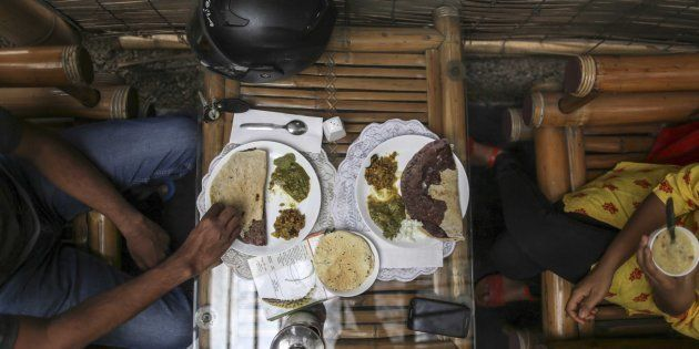 Customers eat plates of food at the Vaathsalya Millet Cafe in Bengaluru, India, on Saturday, June 10, 2017.