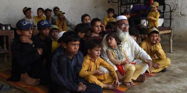 In this photograph taken on May 20, 2017, Pakistani father Gulzar Khan, 57, who has 36 children from...