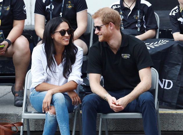 Prince Harry and girlfriend Meghan Markle watch the wheelchair tennis event during the Invictus Games...