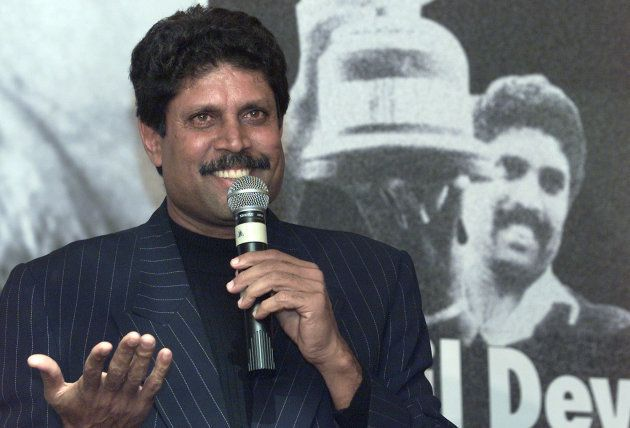 Former Indian cricket coach and captain Kapil Dev gestures during a news conference in New Delhi, November...