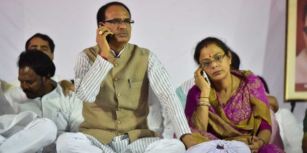 Madhya Pradesh Chief Minister Shivraj Singh Chouhan and his wife Sadhna Singh busy with their cell phones...