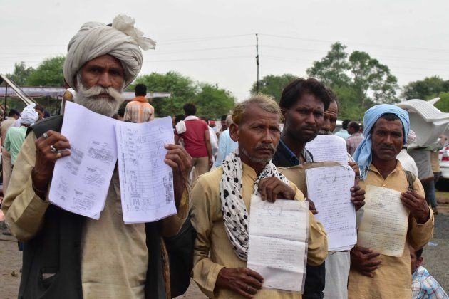 Farmers showing their applications handed over to Madhya Pradesh Chief Minister Shivraj Singh Chouhan...