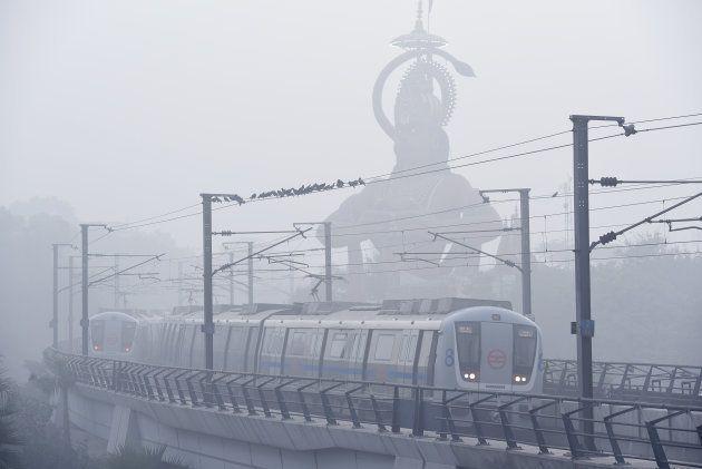 NEW DELHI, INDIA - NOVEMBER 9: Dense fog/Smog in morning resulted in very less visibility at Karol Bagh...