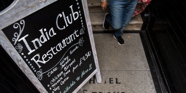 A blackboard stands at the entrance to the India Club restaurant in London on October 16, 2017.Plans to renovate a historic and beloved Indian restaurant in central London are causing a stir, pitting the developers against high profile defenders, including intellectuals, Anglo-Indian businessmen and lawmakers from both countries. / AFP PHOTO / CHRIS J RATCLIFFE        (Photo credit should read CHRIS J RATCLIFFE/AFP/Getty Images)