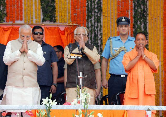 Prime Minister Narendra Modi (L), Uttar Pradesh governor Ram Naik (C) and India?s ruling Bharatiya Janata...