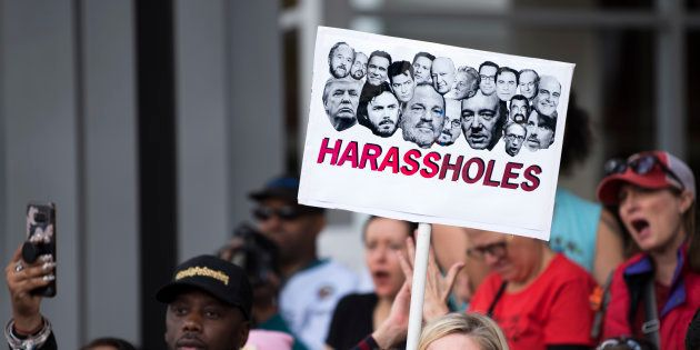 Protesters attend a Me Too rally to denounce sexual harassment and assaults of women in Los Angeles,...