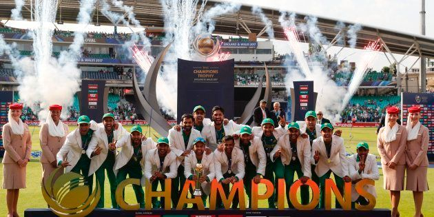 Pakistan players pose with the trophy as they celebrate their win at the presentation after the ICC Champions...