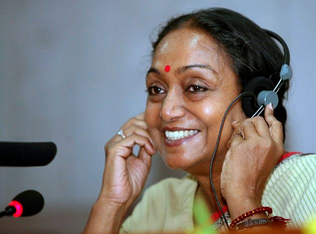 India's newly elected parliament speaker Meira Kumar adjusts her headphone during a news conference in...